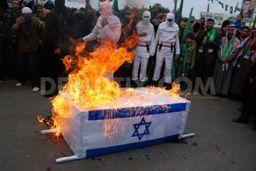 Hamas burning Israeli flag